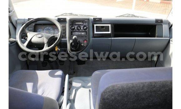 Buy Import Mitsubishi Carisma White Car in Import - Dubai in East Mahé