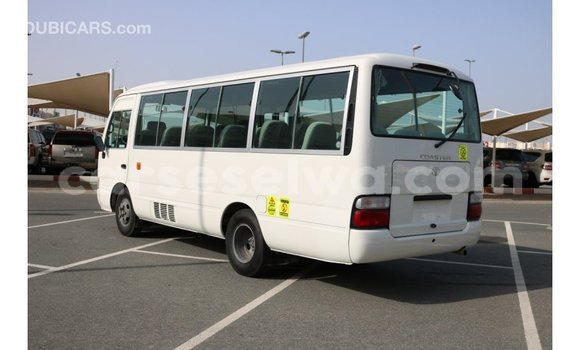 Buy Import Toyota Coaster White Car in Import - Dubai in East Mahé